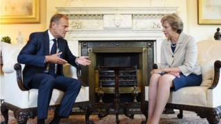 British Prime Minister Theresa May (R) speaks to President of the European Council Donald Tusk (L) during their meeting at 10 Downing Street in London, Britain, 08 September 2016.