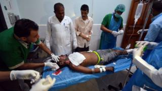 Medics attend to man injured by Saudi-led air strikes on a prison near the Red Sea port of Hudaydah, Yemen, October 30, 2016