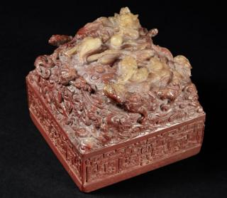 A handout picture taken in November 2016 and released on 14 December 2016 by Pierre Berge and Associes and Drouot shows a Chinese imperial seal of the Qianlong era before its auction at the Hotel Drouot.