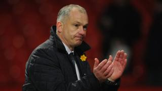 Reading stand named after 'hero' coach