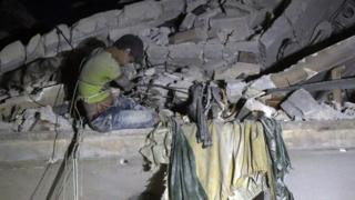 Syrian boy waits to be rescued from Qaterji, Aleppo