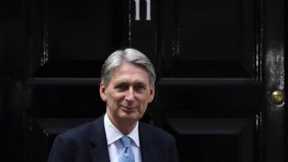 Chancellor of the Exchequer Philip Hammond poses outside 11 Downing Street during his first day in the role on July 14, 2016