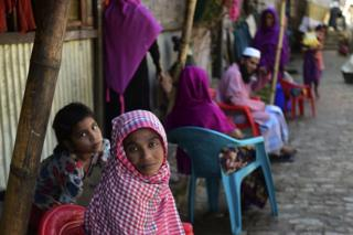 In this photograph taken on 26 November 2016, Myanmar Rohingya refugees look on in a refugee camp in Teknaf, in Bangladesh's Cox's Bazar.
