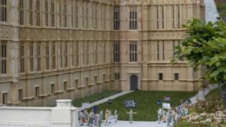 Miniature models depict both sides of the British EU debate during a demonstration in front of a miniature London's houses of parliament at the Mini-Europe park in Brussels