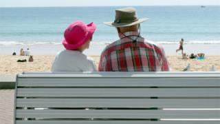 Pensioners on beach