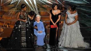 Nasa mathematician Katherine Johnson (second left) appears onstage with actors Janelle Monae, Taraji P. Henson and Octavia Spencer