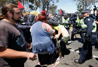 A fight breaks out during anti-Islam protests in Melbourne on Sunday