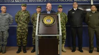 This handout picture released by the Colombian Defence Ministry's press office shows Colombia's Defense Minister Luis Carlos Villegas (C) and the Police and Armed Forces commanders on 1 April