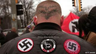 Neo-Nazi protestors organized by the National Socialist Movement demonstrate near where the grand opening ceremonies were held for the Illinois Holocaust Museum & Education Center 19 April 2009