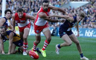 Adam Goodes of the Swans pushes other players at Domain Stadium on 26 July, 2015