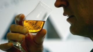 Man tasting whisky
