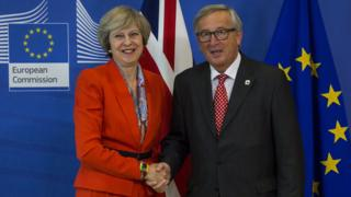 File photo from October 2016 showing Theresa May and Jean Claude Juncker shaking hands.