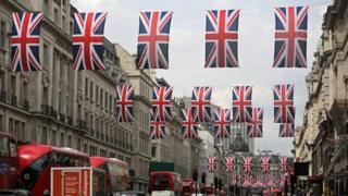 Union flags fly over Regent Street in London