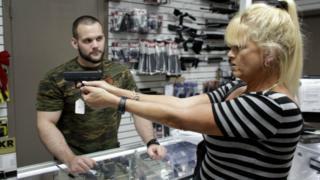 Customer in a gun shop in Pompano Beach, Florida. 5 Jan 2016