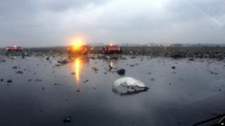 Russian emergency fire trucks are seen among the wreckage of a crashed plane at the Rostov-on-Don airport,