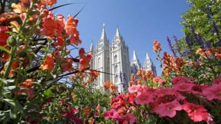 This Aug. 4, 2015,,file photo, flowers bloom in front of the Salt Lake Temple, at Temple Square, in Salt Lake City.