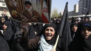 Iranian woman carries poster of Ayatollah Ali Khamenei at anti-Saudi rally in Tehran - 25 September