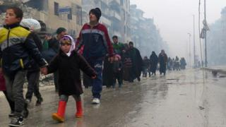 Syrian residents flee violence in eastern Aleppo on 13 December 2016