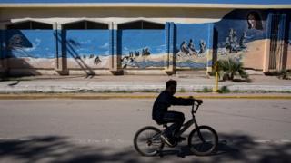 Boy on bike at border