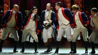 Lin-Manuel Miranda (centre) performing with other Hamilton cast members