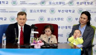 Robert Kelly, left, a political science professor at Pusan National University, holds a press conference with his wife Jung-a Kim, right, and children James and Marion at the university in Busan, South Korea, Wednesday, March 15, 2017