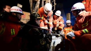 "In this Dec. 28, 2015 photo provided by China""s Xinhua News Agency, rescuers try to contact the trapped people at a collapsed mine in Pingyi County, east China""s Shandong Province."