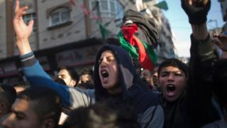 Palestinians chant slogans during a demonstration against the chronic power cuts in the Jabaliya refugee camp