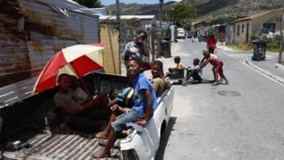 South African children play on a street in Masiphumelele, Cape Town, South Africa - Thursday 1 December 2016