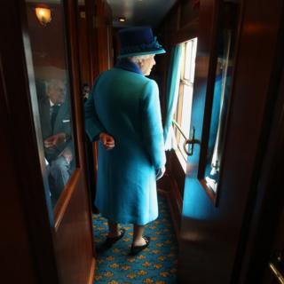 Elizabeth aboard a steam train in Scotland