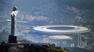 The Christ the Redeemer statue in Rio de Janeiro overlooks the Maracana Stadium