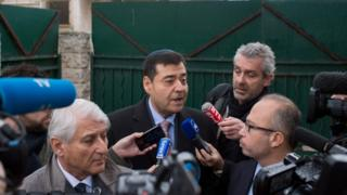 Marseille's Israelite Consistory president Zvi Ammar (centre) speaks to journalists in front of the La Source Jewish school in Marseille, southern France, on 11 January 2016