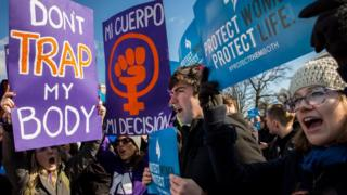 Pro-choice advocates (left) and anti-abortion advocates (right) rally outside of the Supreme Court, March 2, 2016 in Washington, DC