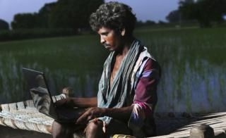 Young farmer in India using the internet