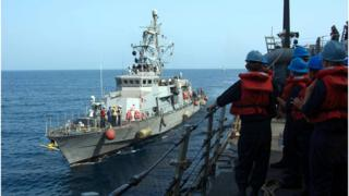 A file image released by the US Navy shows a Cyclone-class patrol craft USS Tempest (PC 2) coming alongside to perform a replenishment-at-sea through rafting with the guided-missile destroyer USS Mason (DDG 87) on September 12, 2016.