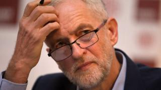 Jeremy Corbyn scratches his head