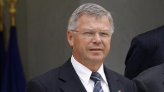 Kjell Magne Bondevik, seen in a close-up, wearing a suit and tie