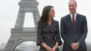 The Duke and Duchess of Cambridge in front of the Eiffel Tower