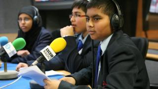 School Reporters working in a radio studio