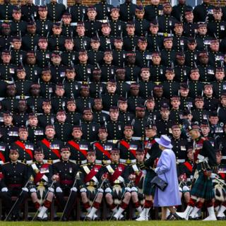 Queen Elizabeth II joining The Argyll & Sutherland Highlanders, 5th Battalion, Royal Regiment of Scotland (5 SCOTS) for a group photograph during her visit to Howe Barracks in Canterbury, Kent