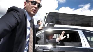 Mr Erdogan waves as he leaves Friday prayers in Istanbul, ahead of his TV speech, 5 May