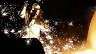 """A worker controlling a tapping of a blast furnace at Europe""""s largest steel factory of Germany""""s industrial conglomerate ThyssenKrupp"""
