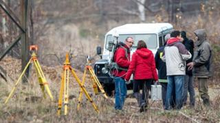 Specialists examine the area near a railway track where an armoured train was allegedly discovered near Walbrzych. 14 Nov 2015