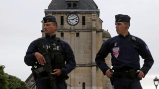 French CRS police outside stricken church near Rouen, 27 Jul 16