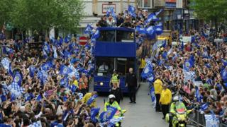 Fans line the streets of Leicester to celebrate promotion to the Premier League