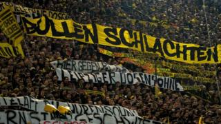 Supporters of Dortmund displaying banners prior to the German First division Bundesliga football match between Borussia Dortmund and RB Leipzig on 4 February