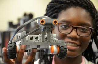 Anaya Neal with a Lego NXT robot at the Black Girls Code Memphis Robot Expo, 19/9/2015