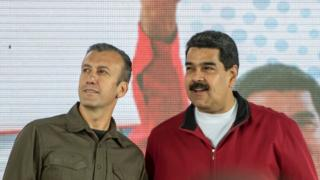 Venezuelan President Nicolas Maduro (R) and his vice-president Tareck El Aissami participate in a rally with workers of PDVSA state-owned oil company in Carcas January 31, 2017.