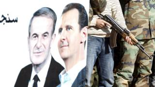 "Syrian civilians who volunteered to join local Self Protection Units to protect their neighbourhoods alongside the Syrian army attend training near a picture of Syria""s president Bashar al-Assad and his father Hafez al-Assad, in Damascus countryside"
