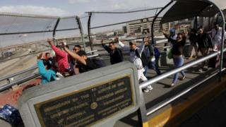 "Cuban migrants gesture after arriving by plane from Panama to Ciudad Juarez, at the Mexican border crossing with El Paso, Texas, February 23, 2016. Nearly 150 Cubans converged on Mexico""s border city of Ciudad Juarez on Tuesday as part of a pilot programme agreed by Central American countries last year to allow the migrants to continue towards the United States. REUTERS"