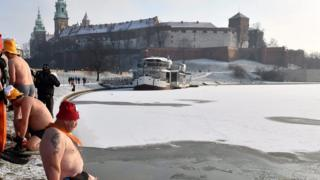 Cold weather enthusiasts, called Walruses, swim in the Wistula river in Krakow